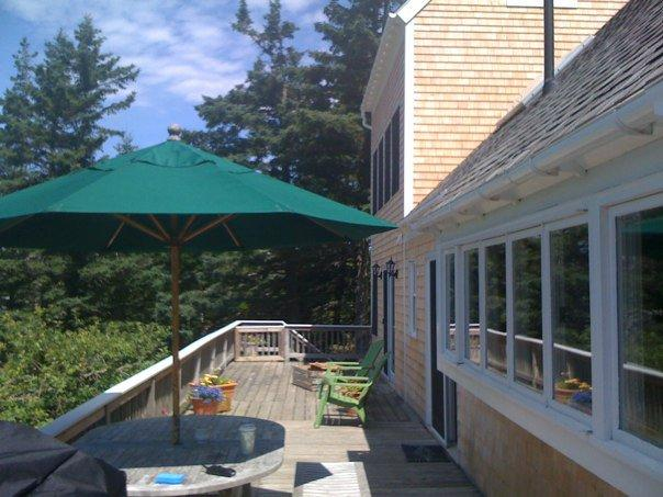 Large deck facing the ocean, perfect for grilling, entertaining, and relaxing