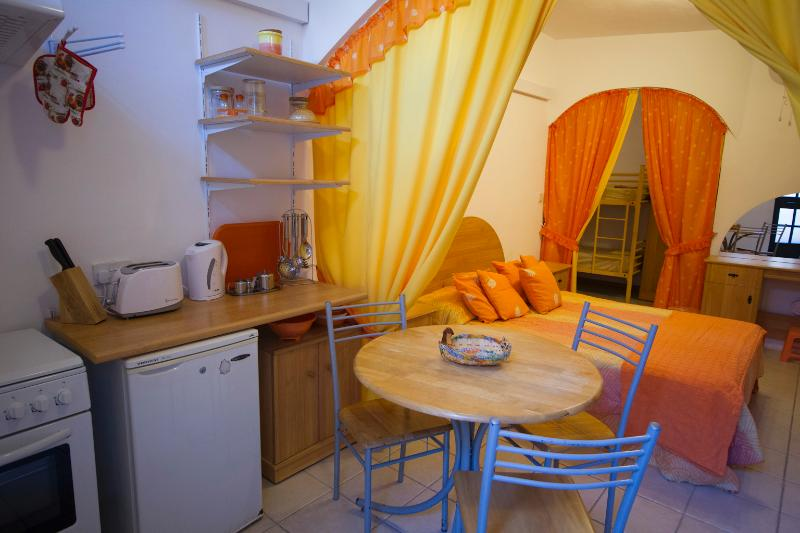 Orange Kitchen, Main Bed, & bunkbed area in background