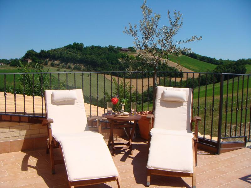 Rondine apartment balcony with sun loungers
