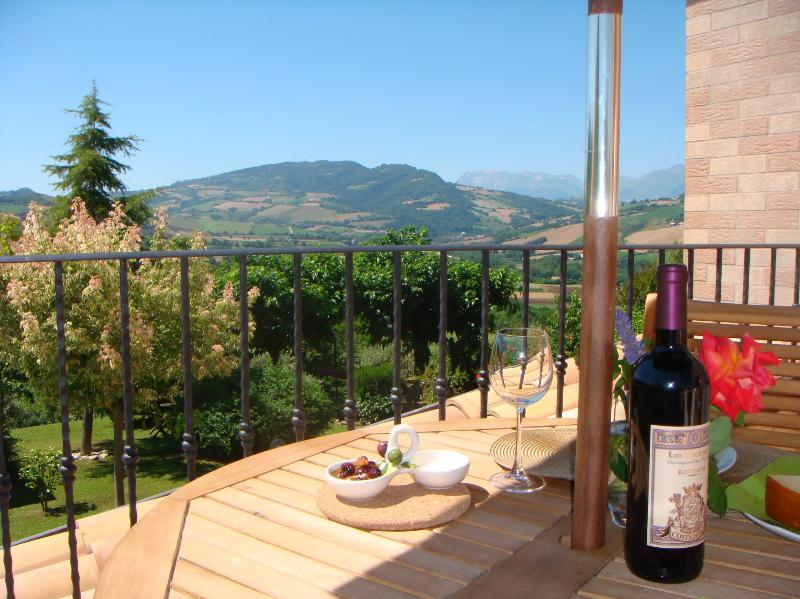 Relax on your private balcony with a glass of Le Marche wine!