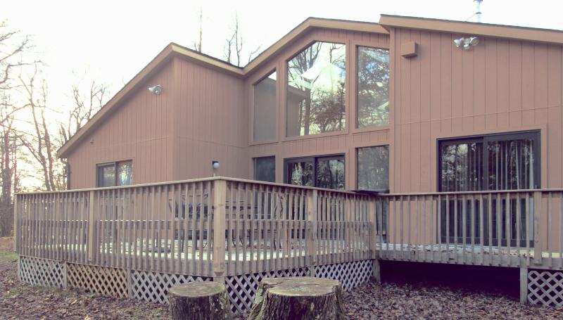 Front View of home with wrap around deck