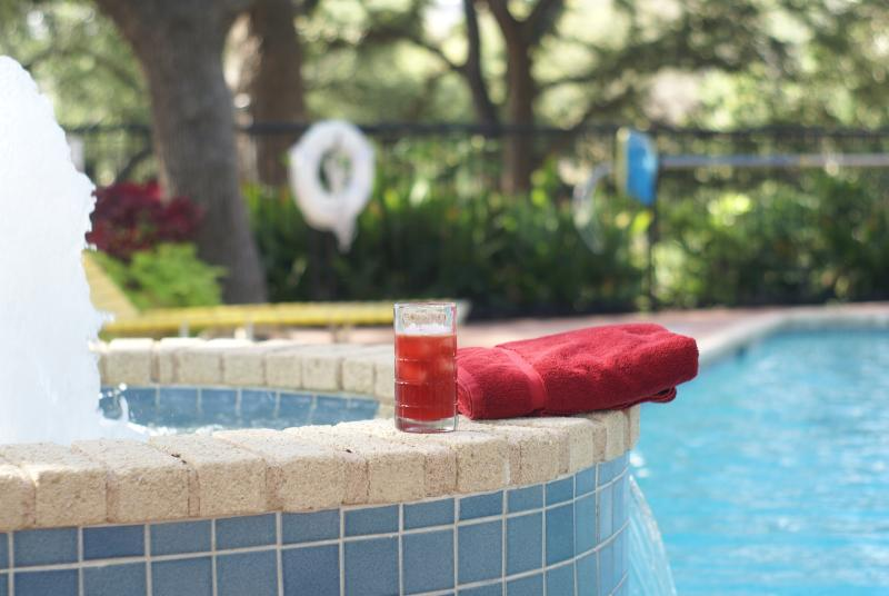 cool off with a drink and a dip in this great pool!