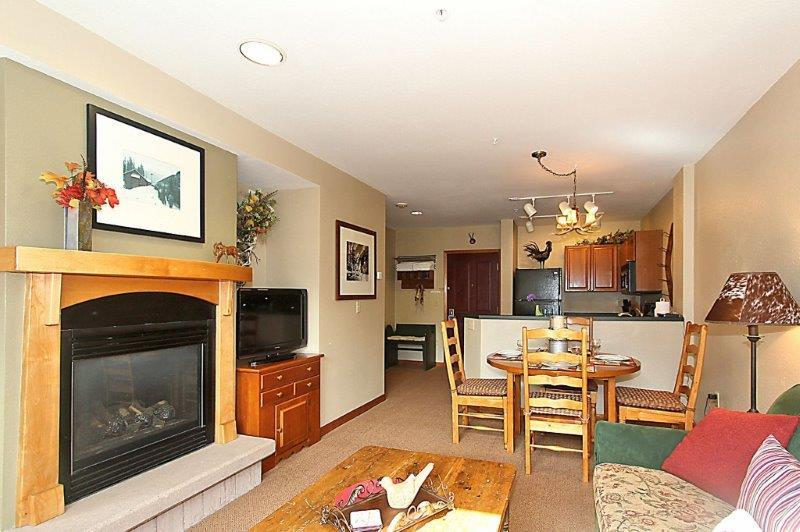 Cuddle up by the fireplace or take in a movie on the flat screen TV.