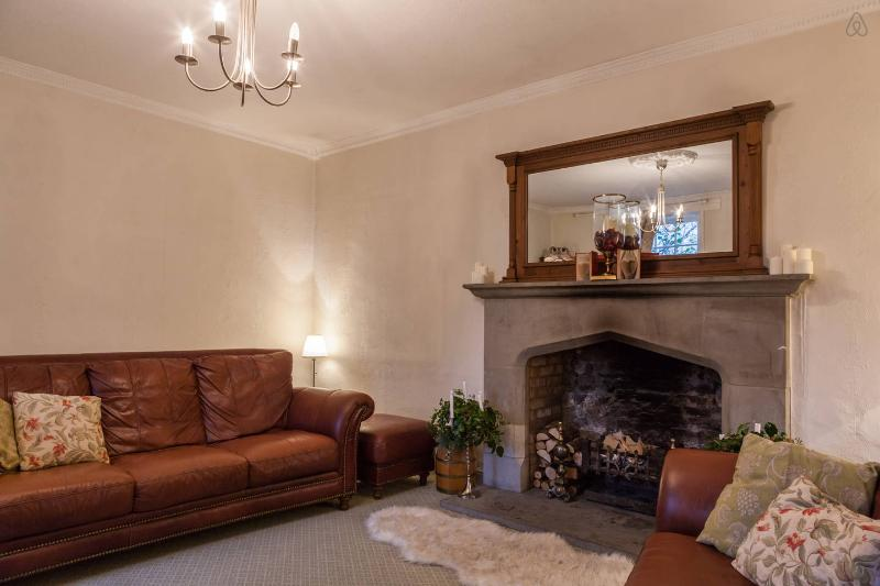 The lounge features a large working fire place and window seats