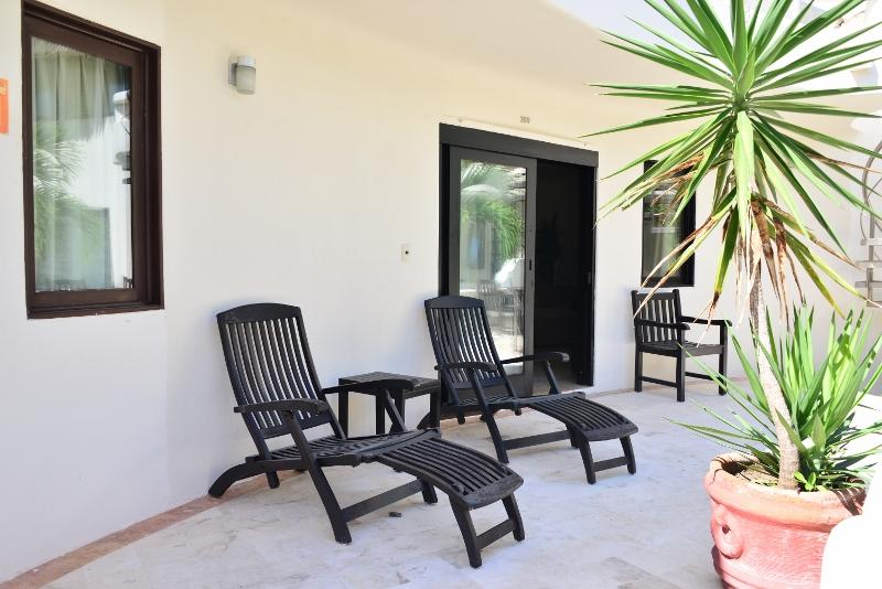 loungers on the terrace in front