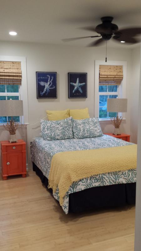 Queen Bed with bamboo floors, ceiling fan with flat screen TV