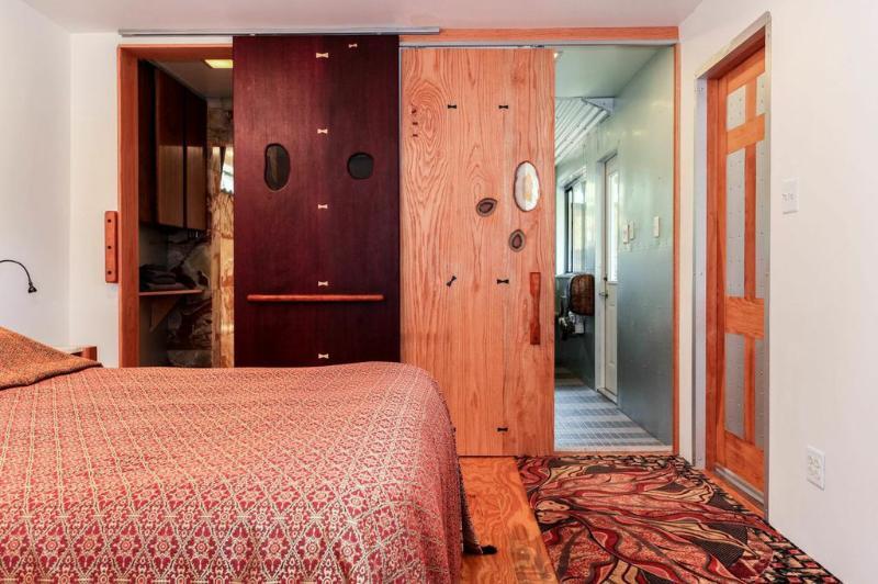 Bedroom. Queen bed with natural latex mattress. Handcrafted doors.