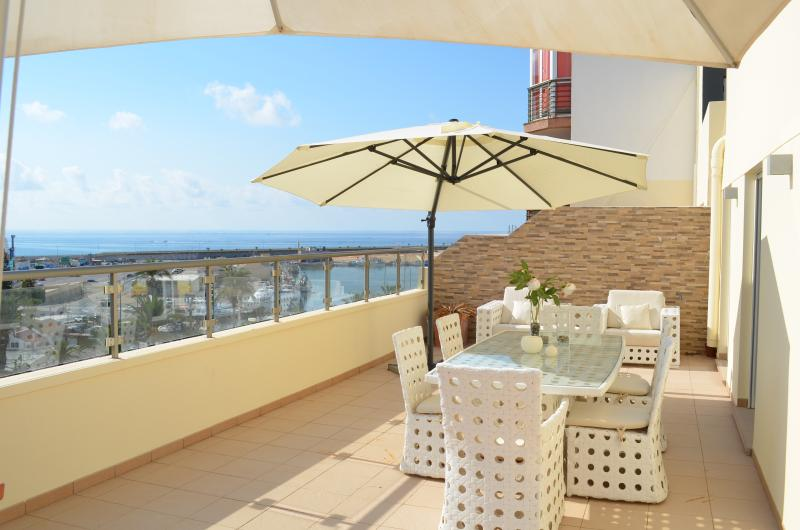Enjoy serene mornings on the terrace & spectacular ocean views of the marina.