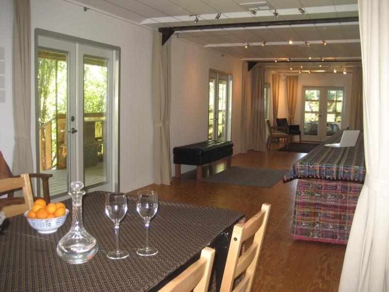 Main room.  French doors open to porch.