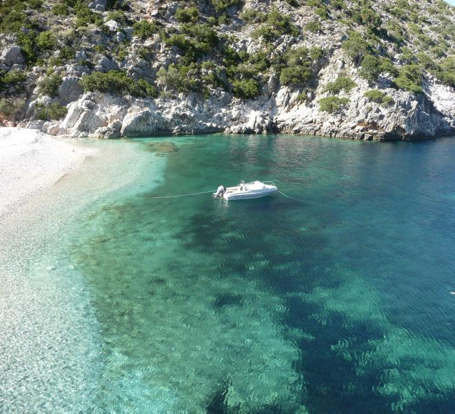 Boating to small bays with gin-clear water