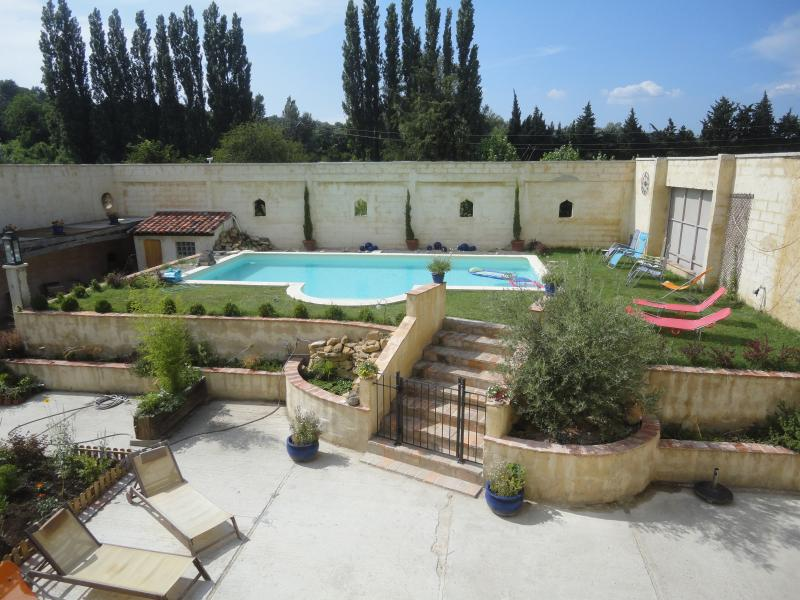Private and sheltered walled garden with pool and sitting/dining areas