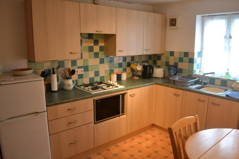 Spacious kitchen with dishwasher, fridge freezer, gas hob & combination oven/microwave