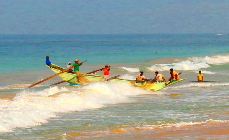 Fishing Boat Riding Surf into Beach Close to Villa