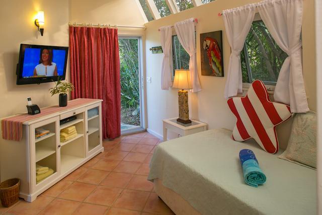 The Sun Kamer op Guest House de 1e verdieping kan worden set-up met een kingsize bed of 2 Twins