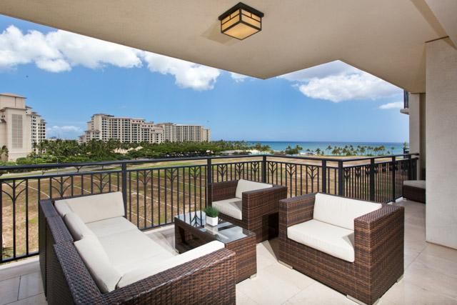 Outdoor living room with unobstructed views of the ocean.