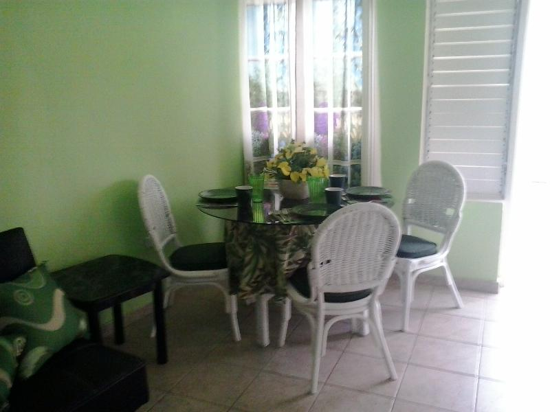 Dining area leading out to balcony