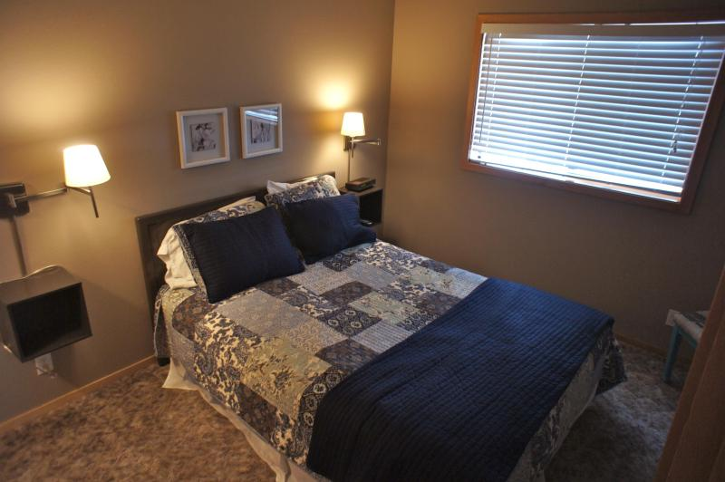 A third bedroom downstairs features a queen