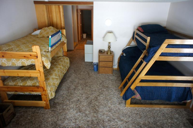 The downstairs family room has two bunks, another TV and Nintendo Wii