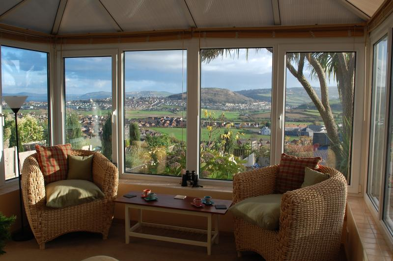 Relax in the conservatory whilst taking in the views of coast and country