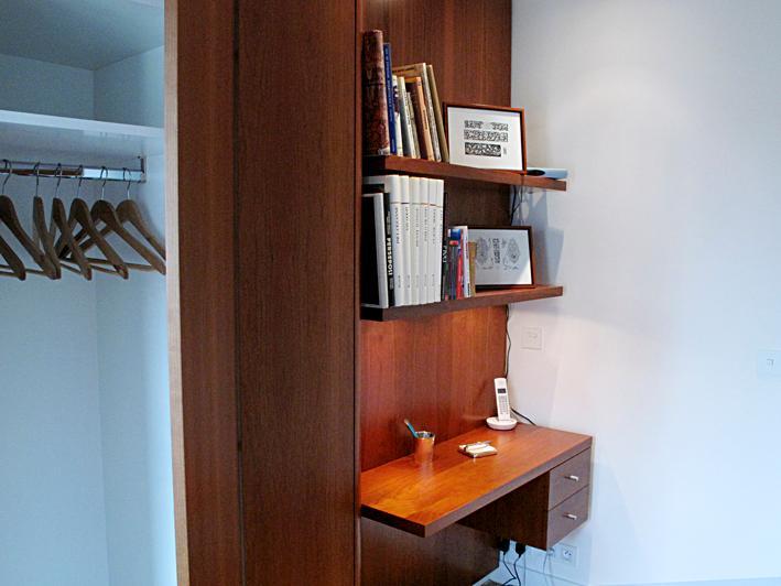 Desk, telephone, precious art books & a selection of handbooks, wardrobe