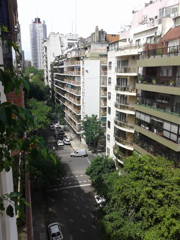 View from the apartment balcony over Paunero Street. A low transit street in the heart of Palermo