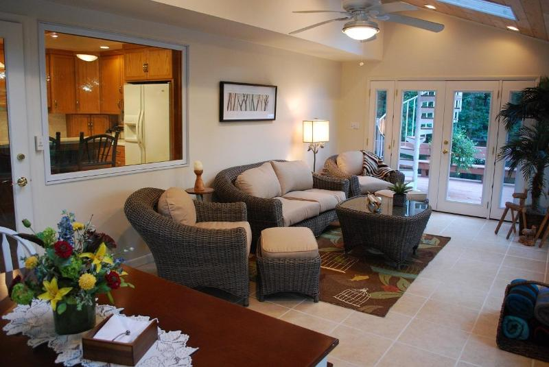 The 4 seasons room has a lovely eating area & easy access to the deck and pool.