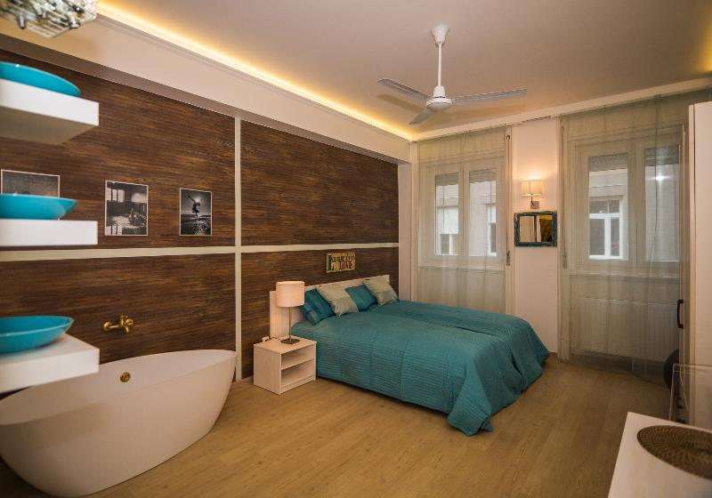 Bedroom with the free standing tub