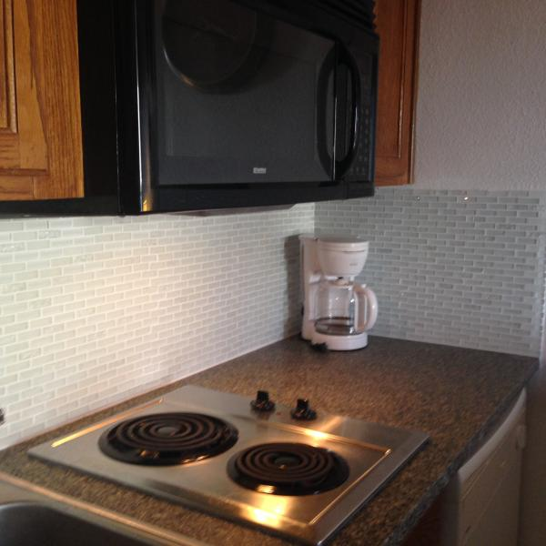 Newly renovated kitchen Silestone counter tops 2 burner stove