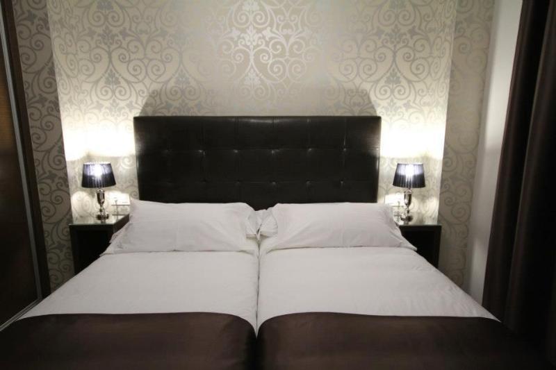 Habitación con dos camas. (Apartamento con cocina, sofá-cama, dormitorio y 1 baño)