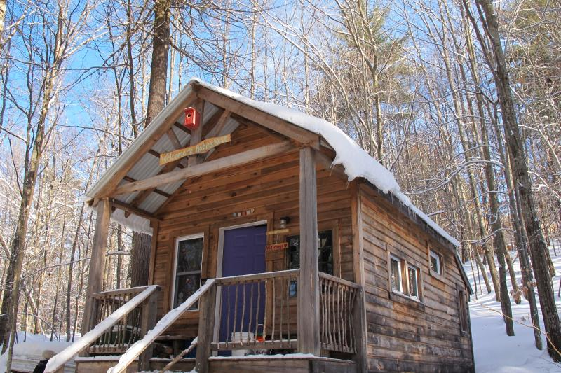 Robins Nest Eco Cabin warm up with wood stove after hiking the land.  Solar powered.