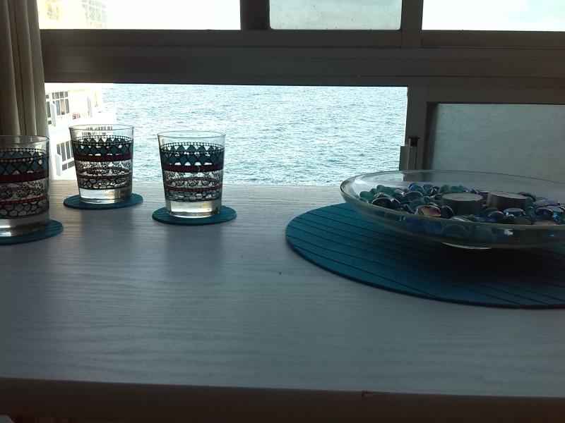 Take a drink watching the sea...