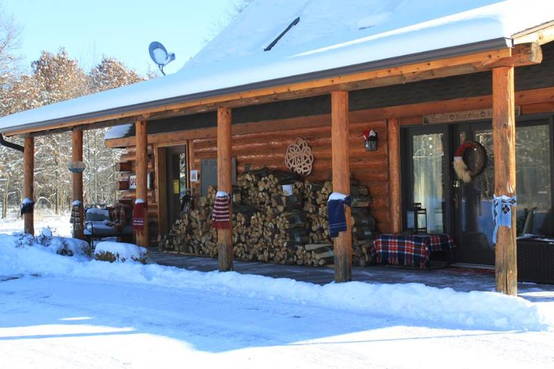 Dressed up for winter! Come inside and get warm by the fireplace.