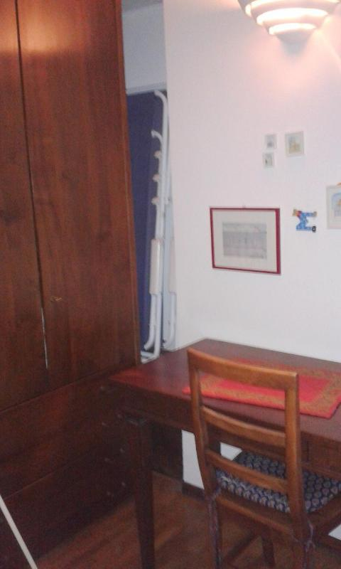 desk and wardrobe in double room