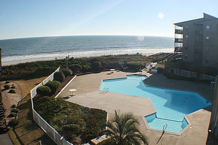 Unit offers beautiful views of the pool and ocean