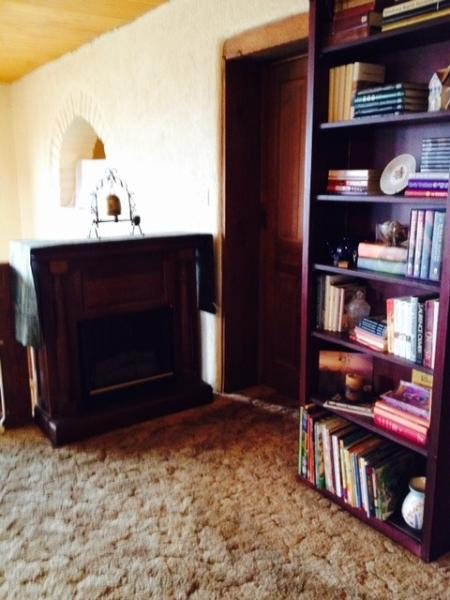 Mock Fireplace (flames from sterno canister), books for reading & door to Bella Tranquillo-Queen bed