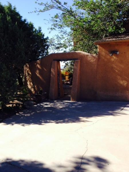 Entry to the private patio & house w/open loft from the driveway shared w/owners & other guests.