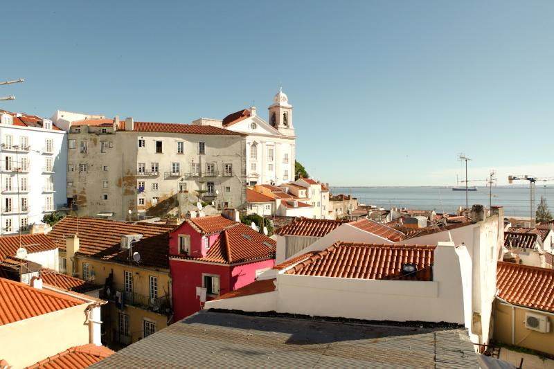 Awesome view facing the river and the Lisbon ' s traditional roofs