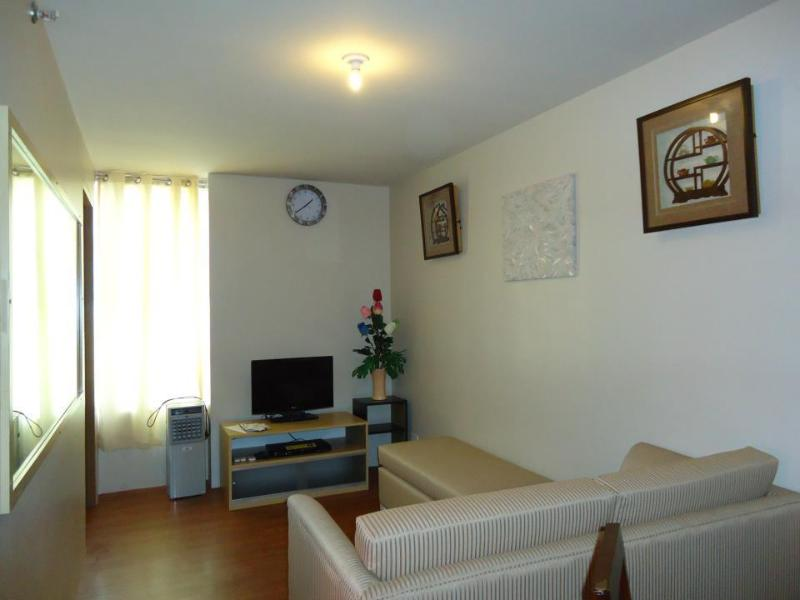Living area with complete furniture and appliances