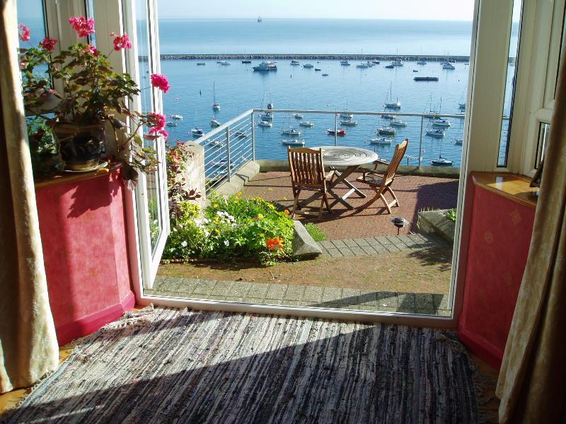 Sea view from Sunberry Cottage living room, showing patio area.