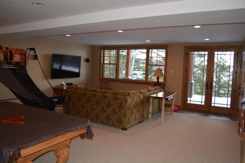 The recreation room and home theater (80') on the lower level, beautiful lake views & walkout