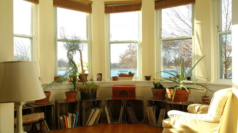 The sunroom offers panoramic views of fountain lake