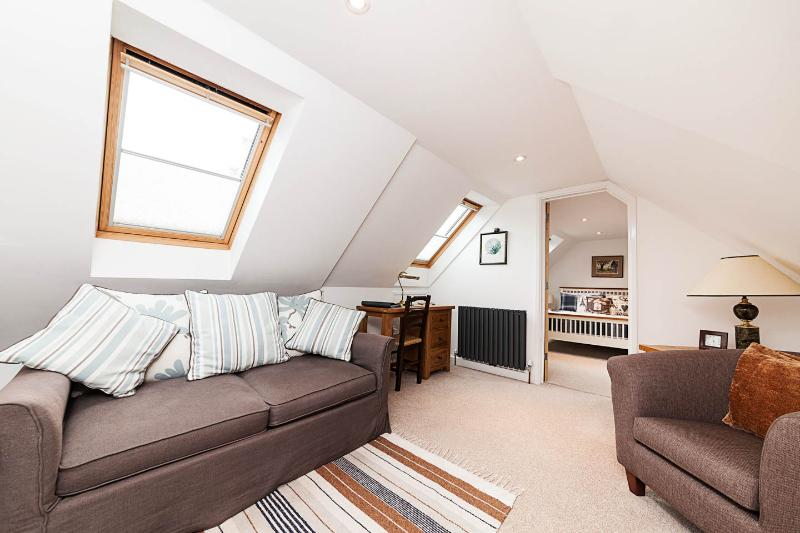 Sitting room with double sofa bed and two roof light windows