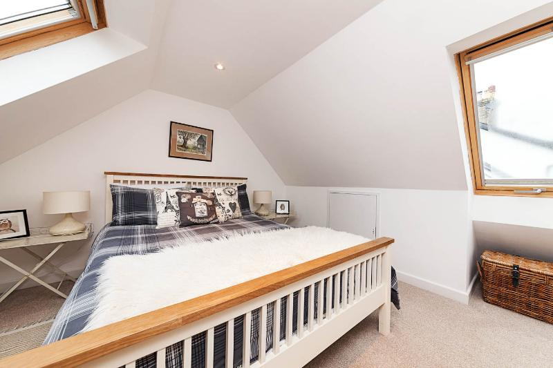 King Size bed in separate light and airy bedroom off the sitting room