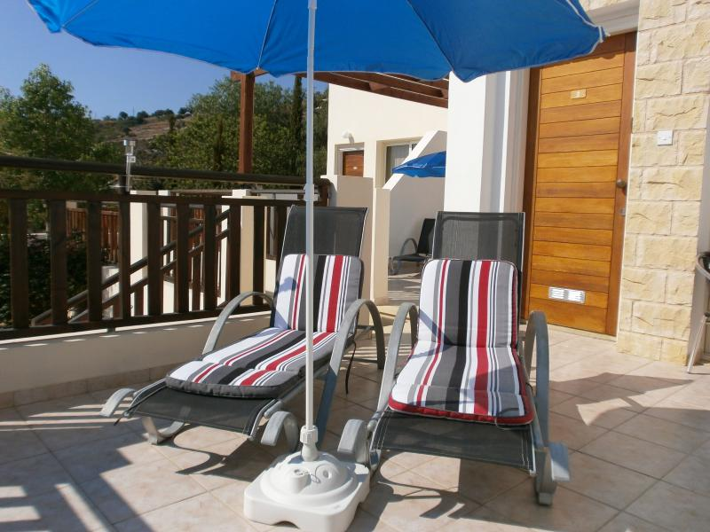 Relax on the apartment sun loungers in the Cyprus sunshine