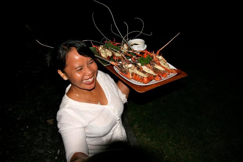 Ketut serving you dinner