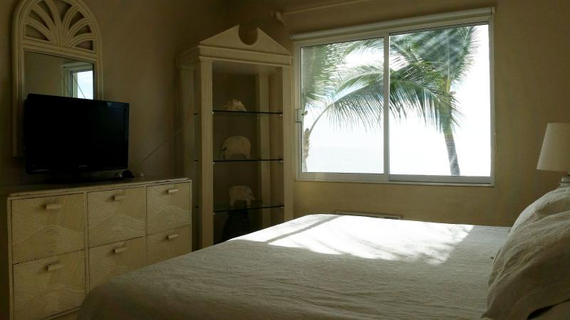 master bedroom with california king size bed and spectacular ocean views