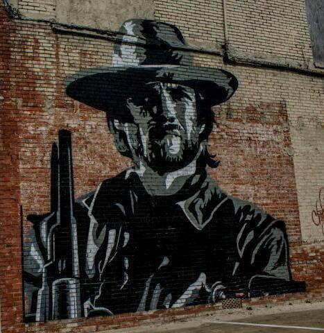 Outlaw Josey Wales is a 18' X 22' mural painted on the side of the Hooker Hotel