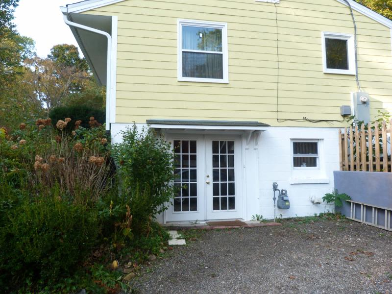 Private entrance to basement apartment with off-street parking