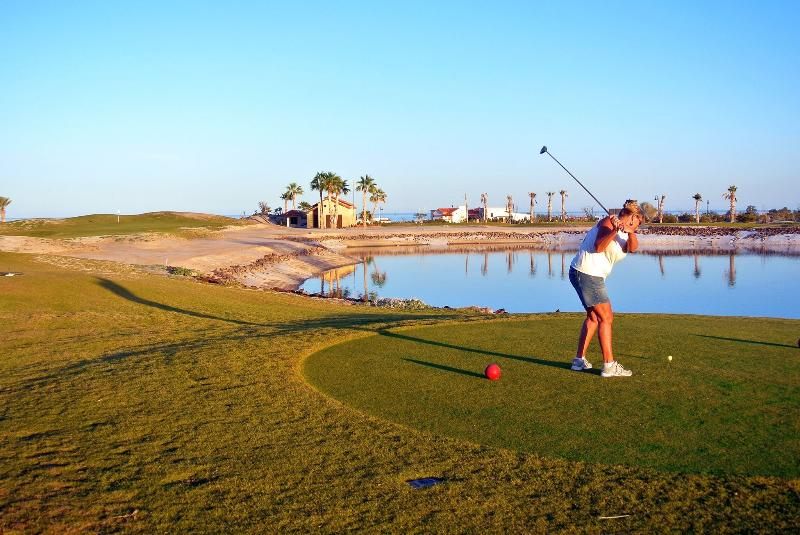 Playing the 18-hole golf course in our resort