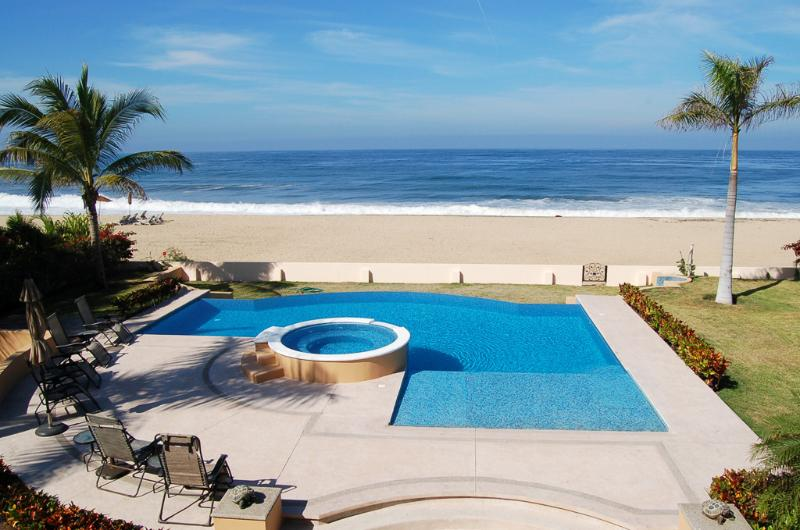 View of the pool & the beach from the upper terrace